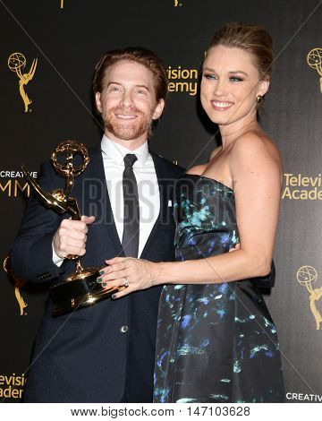 LOS ANGELES - SEP 11:  Seth Green, Clare Grant at the 2016 Primetime Creative Emmy Awards - Day 2 - Arrivals at the Microsoft Theater on September 11, 2016 in Los Angeles, CA