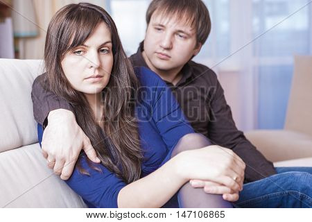 Family Concepts and Ideas. Young Caucasian Couple in Troubles Having Difficulties and Depressed. Horizontal Image Orientation