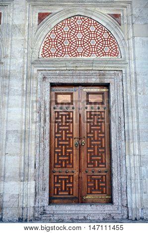 Istanbul, Turkey - November 5, 2015. Exterior wooden door of Shehzade Mehmet mosque in Istanbul, with mosaics above.