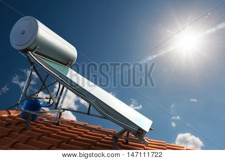 Solar panel with water tank on the roof of a house