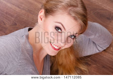 Young Cheerful Lady Lying On Floor.