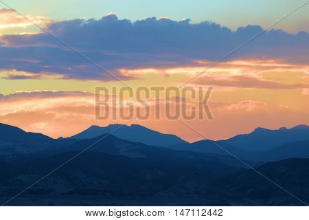Front Range of the Rocky Mountains taken during sunset from Denver, CO