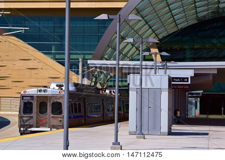 Denver, CO - September 12, 2016:  RTD Light Rail Train at the Denver International Airport Station ready to depart to Union Station Denver which is a major transportation hub linking buses, light rail, and Amtrak to connect Denver Metro and beyond.
