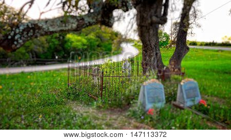 Tiny cemetery sits under an old oak tree in the famous Texas Hill Country near fredericksburg