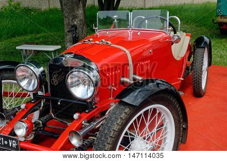 Kharkiv Ukraine - May 22 2016: Retro car red Fiat Roadster manufactured in 1949 is presented at the festival of vintage cars Kharkiv Retro Rally - 2016 in Kharkiv Ukraine on May 22 2016