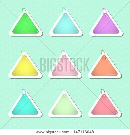 Triangle paper sticker shapes with paper clips in pastel colors.