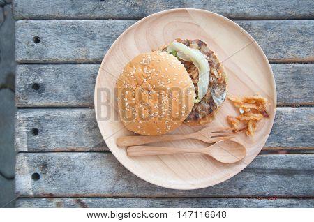 Junk food yummy Meat hamburger on wooden table
