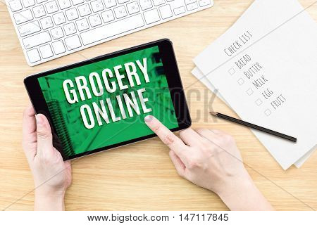 Finger Click Screen With Grocery Online Word With Keyboard On Wooden Table,digital Marketing Concept