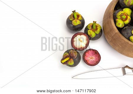 Close up mangosteen fruits isolated on white background Copy space
