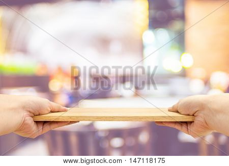 Two hand holding food plate made from wood isolated on white background Template mock up for adding your product and leave space for adding content Clipping path on object.