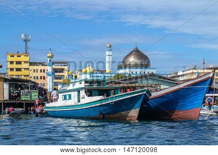 Semporna,Sabah-Sep 10,2016:Semporna bajau traditional water village with background of Ar Rahman Mosque Semporna & traditional fishing boats is a popular tourist attraction at Semporna,Sabah,Borneo,Malaysia.