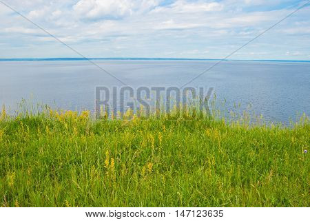 Green lawn on the banks of the Volga river