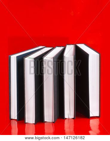 Five big books on a red background