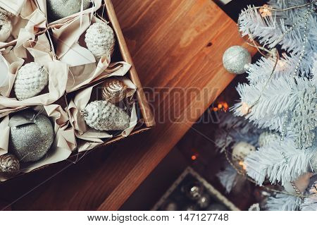 white and silver Christmas decorations in box celebrating New Year 2017 at home