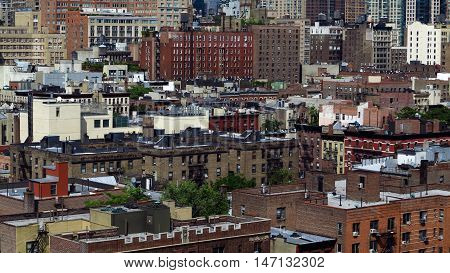View of the buildings of Lower Manhattan area of New York. Photo taken from the roof top of a hotel. Light, natural colors.