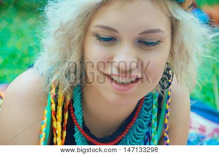 young women with blond hair in a clothes in gypsy style in a summer park