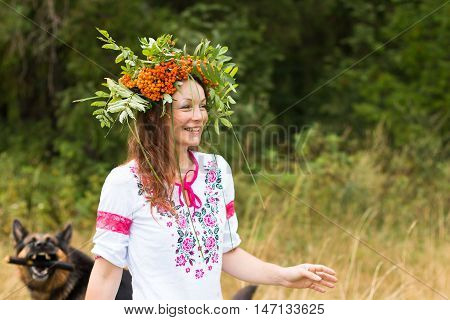 Pretty Girl In National Dress In A Forest