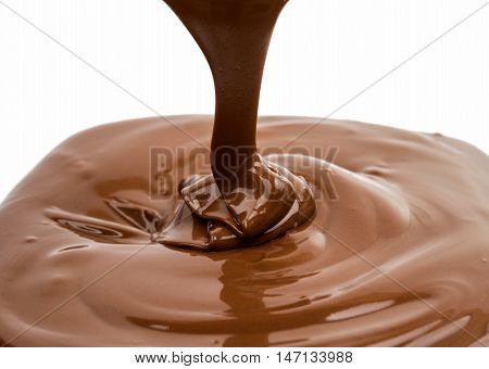 Chocolate flow isolated on white background close