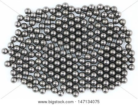 A pile of shotgun pellets on white background
