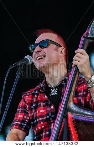 St. Petersburg, Russia - 12 August, Musician wearing sunglasses at the microphone,12 August, 2016. Pop and rock musicians on Harley Davidson festival in St. Petersburg.