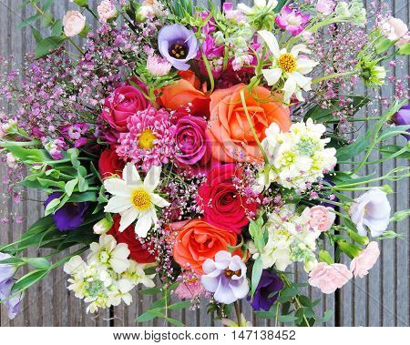 Multicolored spring flowers, close-up. Bunch of colorful flowers or flower bouquet with various flowers.
