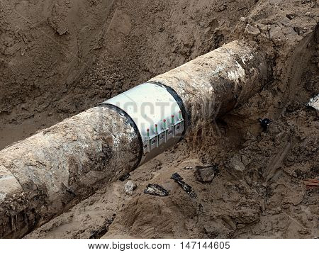 Excavation Pit. Old Drink Water Pipe With  Stainless Repairing Sleeve Members.