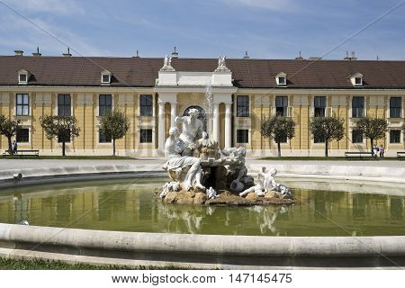 VIENNA, AUSTRIA - September 3, 2016: Detail of the fountain with the statues of Danube Inn and Ennsin in the forecourt of the Schonbrunn Palace in Vienna, on September 3, 2016 in Vienna, Austria