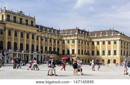 VIENNA, AUSTRIA - September 3, 2016: Tourists and the baroque Schonbrunn Palace a former imperial summer residence located in Vienna, on September 3, 2016 in Vienna, Austria