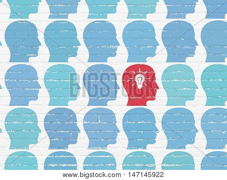 Business concept: rows of Painted blue head icons around red head with light bulb icon on White Brick wall background