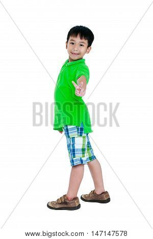Full body of happy asian child in leather shoes smiling and looking at camera. Stylish boy having fun and standing at studio. Isolated on white background. Studio shot. Positive human emotion.