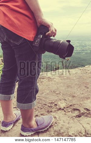 Woman With Digital Camera At View Point On Mountain. Travel Lifestyle Vacations Concept