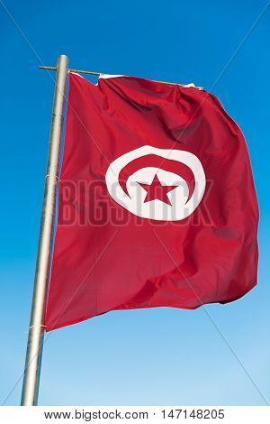 Waving National flag of Tunisia on flagpole