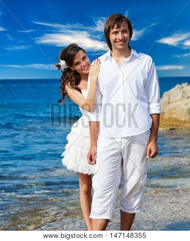 A just married beautiful couple on the sea beach