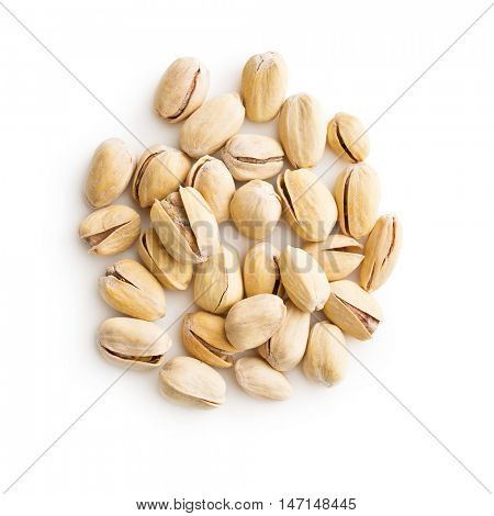 The pistachio nuts isolated on white background. Top view.