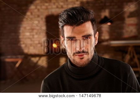 Portrait of handsome young man, looking at camera in turtleneck.