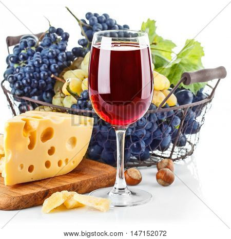 Goblet red wine with blue grapes in basket cheese and nut. Isolated on white background