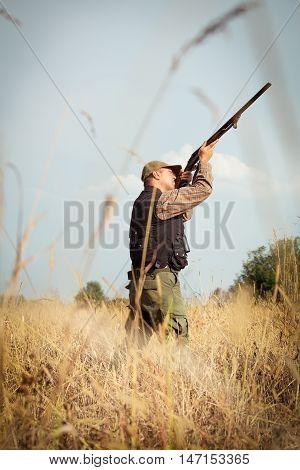 Hunter wild duck hunting with new shotgun