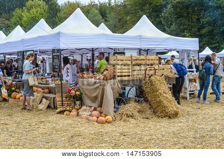 Kyiv Ukraine - September 10 2016: Local producers presented at the farmers market of good food - apples pumpkins etc. Big farmer's market of healthy food was organized by Good Wine company.