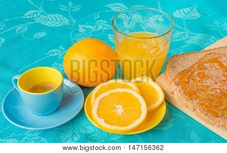 Good morning with orange juice bread and jam