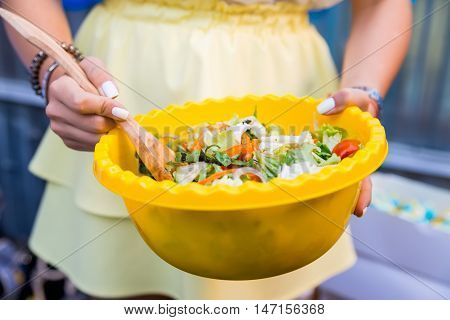 Fresh rustic salad made of various vegetables in a bowl
