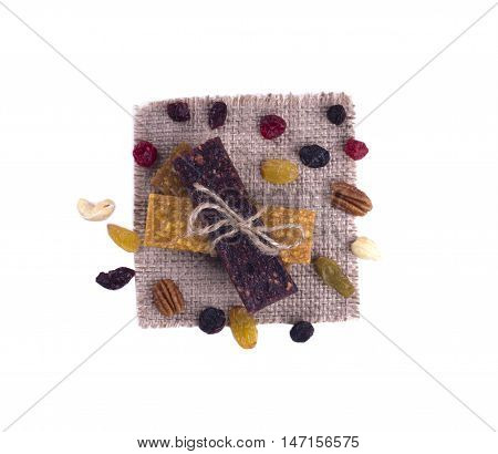Fruit Bars Lie On Each Other On The Cloth Tied With Twine. Nuts And Dried Fruits Are Near.