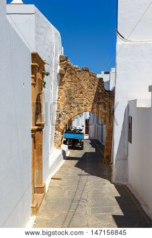 Narrow street and stone stairs in old town Lindos