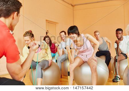 Pilates class training with expanding band at the gym