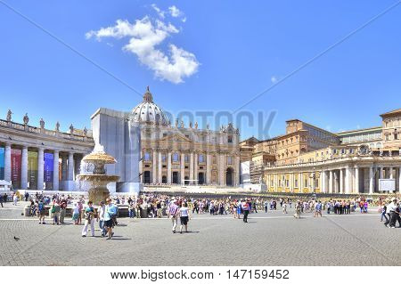VATICAN EUROPE - May 03.2012: Famous Square Saint Peter in Vatican. Tourists and believing christians go to the temple
