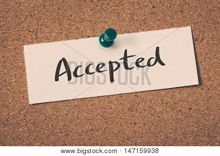 Accepted note pin on the bulletin board