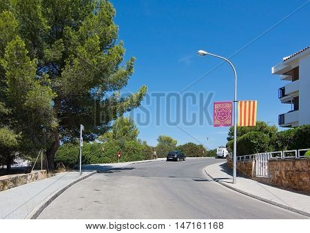 Curved Street With Moorish And Christian Flags