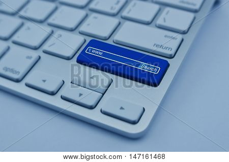 Search www icon on modern computer keyboard button Searching system and internet concept blue tone