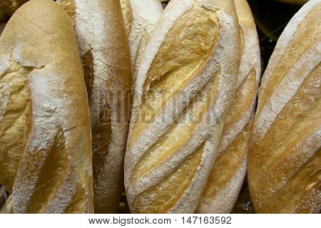 Some loaves of white bread for sale.