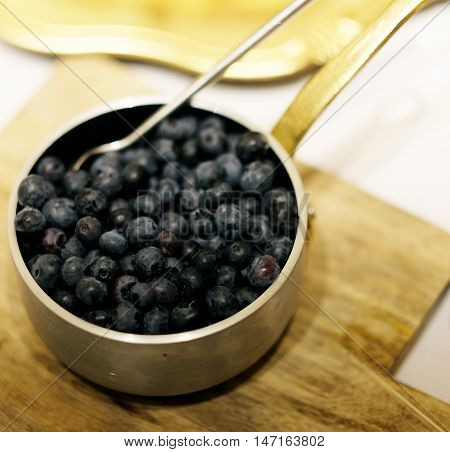 Bowl of bilberries or blueberries, Healthy food Bilberries in a bowl, blueberries in a bowl. Fresh blueberries close up. Bilberries close up