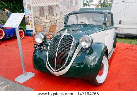 Kharkiv Ukraine - May 22 2016: Retro car green Fiat Topolino manufactured between 1936 and 1955 is presented at the festival of vintage cars Kharkiv Retro Rally - 2016 in Kharkiv Ukraine on May 22 2016